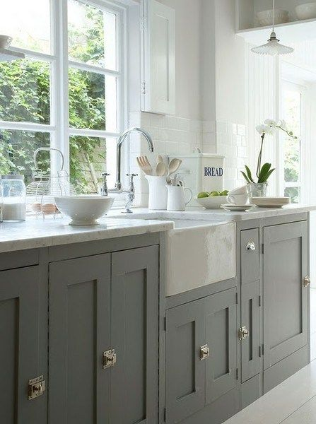 Grey kitchen cabinets serve as the perfect contrast to a bright, white space!