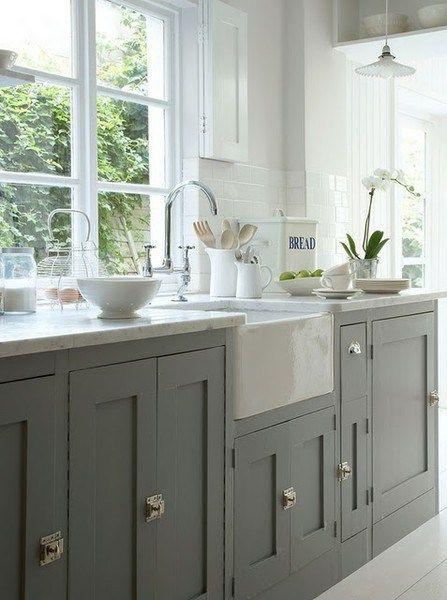 Grey kitchen cabinets serve as the perfect contrast to a bright, white space!  #creative #homedisign #interiordesign #trend #vogue #amazing #nice #like #love #finsahome #wonderfull #beautiful #decoration #interiordecoration #cool #decor #tendency #brilliant #kitchen #love #idea #cabinet #art #worktop #cook #modern #astonishing #impressive #furniture #art #diy