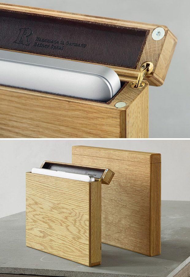 Wooden Laptop Case  Berlin-based furniture designer, Rainer Spehl, works with wood, blending natural textures & tones into rich architectural interiors. With his wooden laptop cases (made to fit all three sizes of MacBook Pro), he's got an original masterpiece. Featuring a magnetic closure with recessed hinges and a full leather lining, these cases will keep your apple from getting bruised.