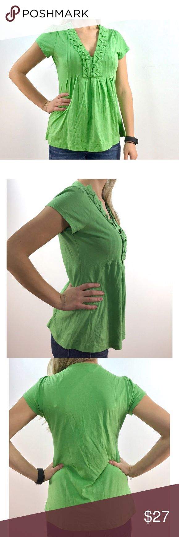Banana Republic Green Short Sleeve Top This preloved size S top has short sleeves and v neck. The fitted bust is embellished with origami-style decorations along the neckline. Preloved items have normal wear and tear. 55% cotton; 45% modal. Banana Republic Tops Tees - Short Sleeve