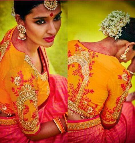 South Indian bride. Gold Indian bridal jewelry.Temple jewelry. Jhumkis.Pink and mustard yellow silk kanchipuram sari.Bun with fresh jasmine flowers. Tamil bride. Telugu bride. Kannada bride. Hindu bride. Malayalee bride.Kerala bride.South Indian wedding.