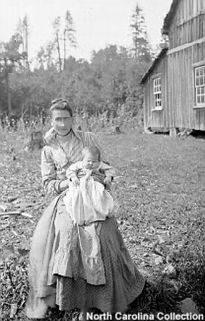 Woman holding an infant, early 1900s. McDowell County, NC.