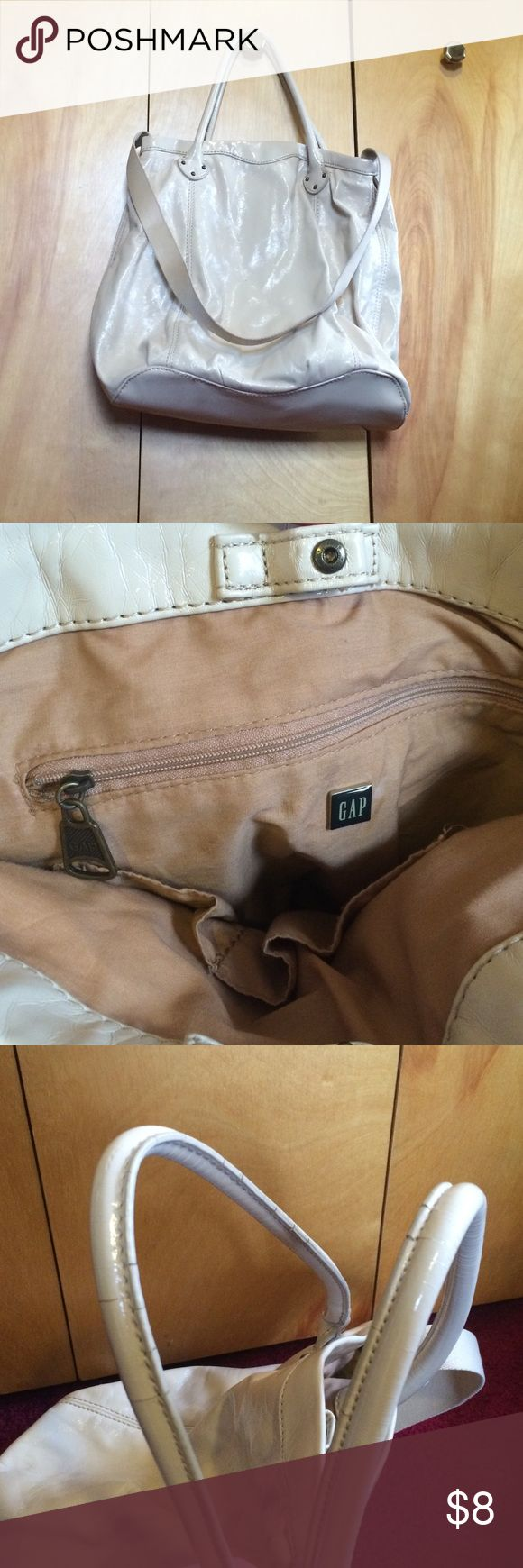 Gap Bag Cream colored Gap bag with shorter and longer handle as pictured. Bag is faux leather, has one zippered pocket and 2 open pockets on inside as pictured. Double handles have slight cracking as pictured. Worn 4-5x. GAP Bags Hobos