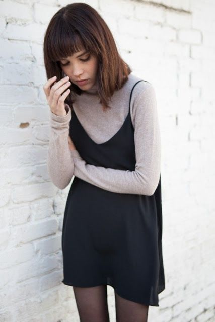Little black dress over turtle neck grey sweater.