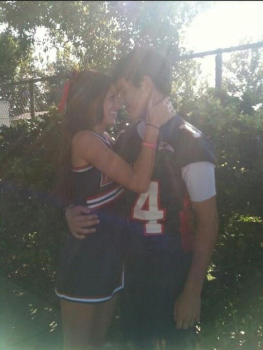 cheerleader and football player