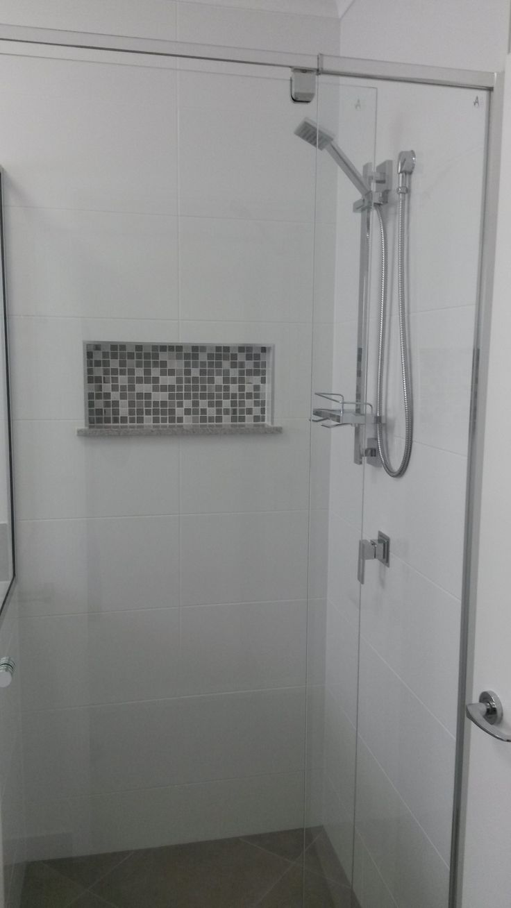 feature tile to shower niche in bathroom. house built by Grady Homes, Australia