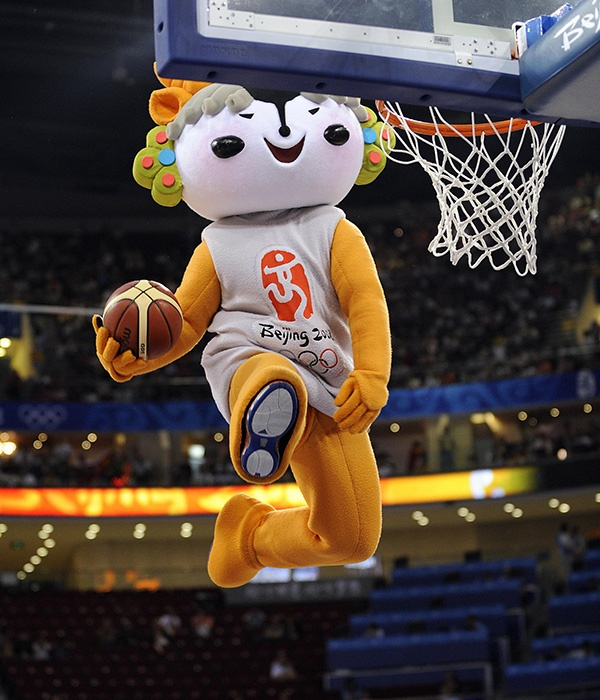 Yingying, one of the Beijing 2008 Olympic mascots jumps for the basket before the women's semi-final basketball match between China and Australia. (Photo by Timothy A. Clary/AFP/Getty Images)