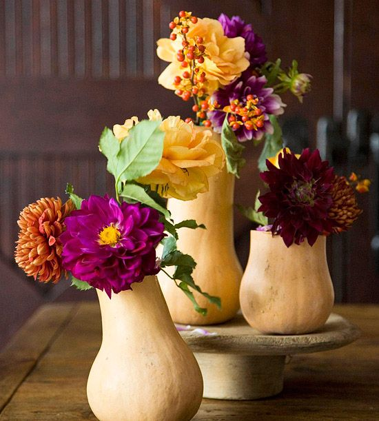 Fall Flowers in Gourd Vases  Display these pretty fall flowers in hollowed-out gourds for a unique twist on a fall centerpiece. Select flowers in a variety of autumn hues, such as bright purple, orange, and yellow, and accent the small bouquets with sprigs of orange berries.