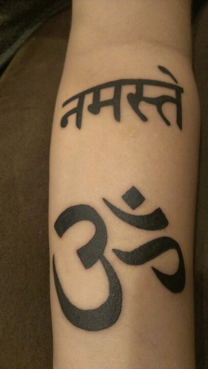 My left arm Namaste and Om work done by Wolfman at Rat Daddy tattoos in Warrington, Mo