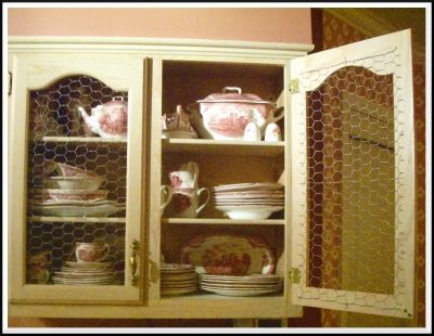 Makeover a cabinet door with chicken wire panels chicken for Chicken wire kitchen cabinets