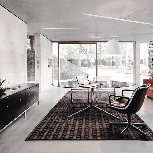 "Florence Knoll referred to her 1961 line of desks as the ""meat and potatoes"" needed to fill in gaps in the Knoll Collection. http://www.yliving.com/florence-knoll-78-inch-oval-table.html"