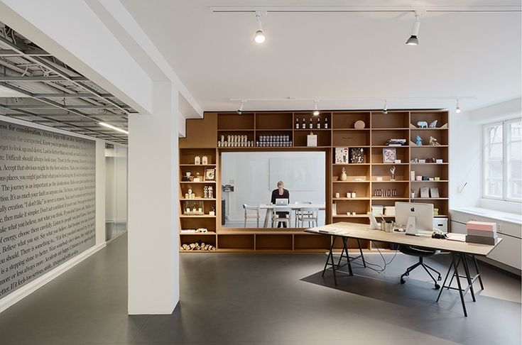 a feeling of openness, transparency and communication has been established inside this light-filled workspace of a graphic agency.