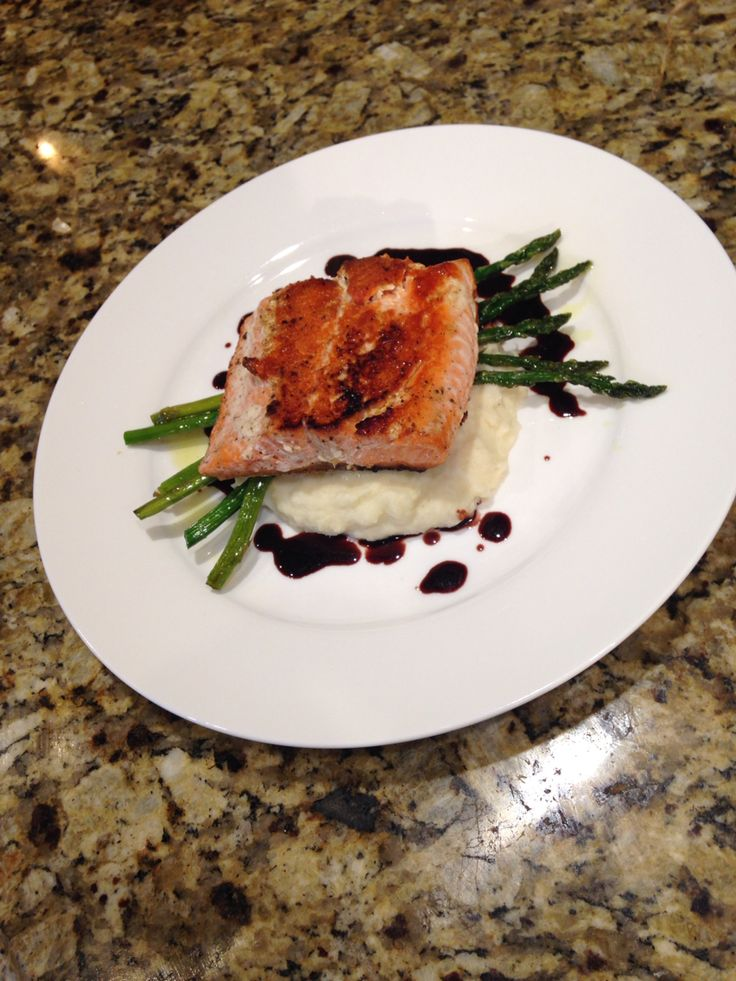 Salmon with a roasted parsnip and potato puree and roasted asparagus.