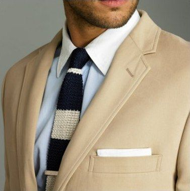 sweet knit tie, contrast collar, and camelhair jacket