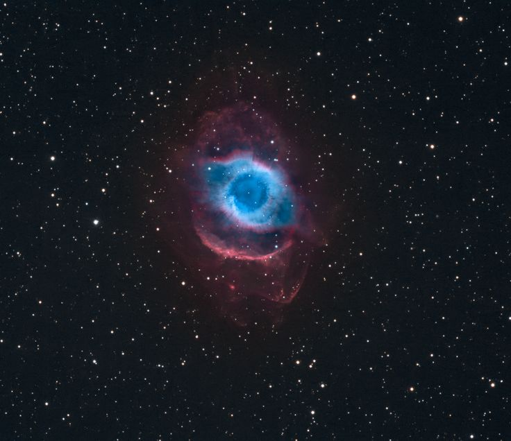 A mere seven hundred light years from Earth, in the constellation Aquarius, a sun-like star is dying. Its last few thousand years have produced the Helix Nebula (NGC 7293), a well studied and nearby example of a Planetary Nebula, typical of this final phase of stellar evolution. A total of 58 hours of exposure time have gone in to creating this deep view of the nebula.