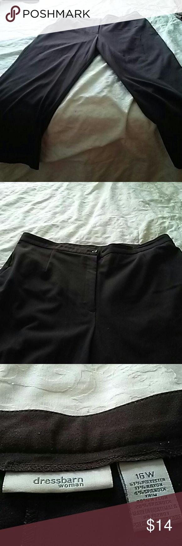 Dress Barn slacks Dark brown slacks, pleated no pockets. Please see last picture there are 2 pin size holes in the hem of the left hem. Unnoticeable however wanted to disclose. Pants are long if you are normal or petite you could have hemmed an that would take care of it. Dress Barn Pants Trousers