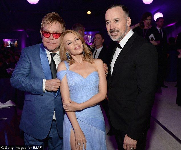 Old friends: Kylie Minogue was another high-profile guest at the 2015 Elton John Oscar Viewing Party. Here she poses with Elton and his husband David Furnish.