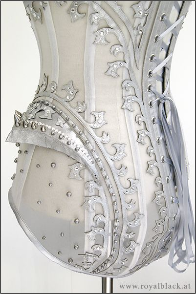 http://www.steampunktendencies.com/ - white and silver corset omg want