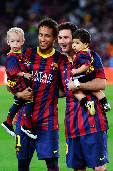 Neymar of FC Barcelona with his son Davi Lucca (L) and his team-mate Lionel Messi of FC Barcelona with his son Thiago pose for a photo prior to the La Liga match between FC Barcelona and Real Sociedad de Futbol at Camp Nou on September 24, 2013 in Barcelona, Catalonia. Welcome to shop Cheap Neymar and Lionel Messi Soccer Jerseys from startupalaska.com.