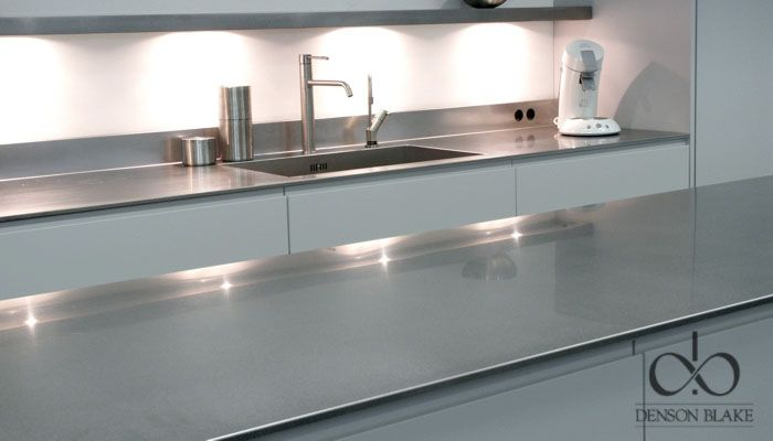 Simple clean lines warmed by the lighting. The stainless compliments the colour of the kitchen