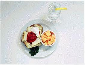 Baked potato – 305 Calories  1 medium baked potato  2 tablespoons sour cream  2 tablespoons salsa  1 cup sliced melon  12 oz water
