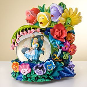 Alice in Wonderland  Description:  It's a beautiful day in the garden with our Golden Afternoon Alice in Wonderland Snowglobe. Brightly-colored flowers serenade Alice as she sits with the bread-and-butterflies on our whimsical, playful snowglobe.