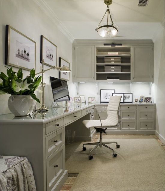 home office with gorgeous greige cabinets, glass topped desktops, traditional accents and a contemporary desk chair