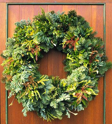 this wreath combines Japanese cedar, blue cypress, Lily-of-the-valley bush, shore pine, huckleberry, and noble fir. it makes the wreath so alive & dimensional!