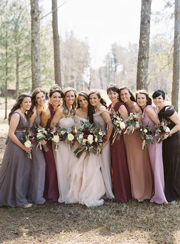 Have bridesmaids dress in mismatched but coordinated dusty colors for an Autumn/Winter wedding - looks fab