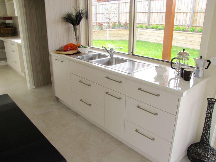 Custom kitchen cabinetry flush into window reveal.