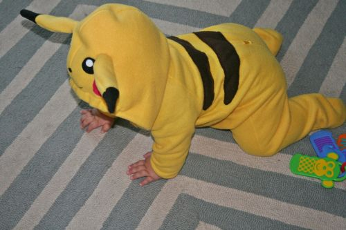 I blogged earlier this month about how I was in the midst of sewing a Halloween costume for Dakota. To recap: I decided on making a pikachu costume by modifying a Simplicity costume sewing pattern....