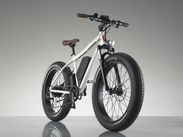 RadRover™ electric fat bike. White frame with brown leather grips and saddle.
