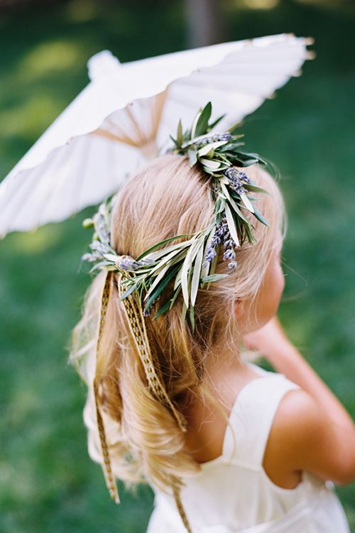 Flower girl with a lavender crown   Photography by Leah   Brides.com