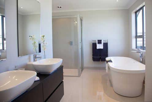 Twin vanities and a free standing bath are two top line features in this ensuite bathroom on the second storey.