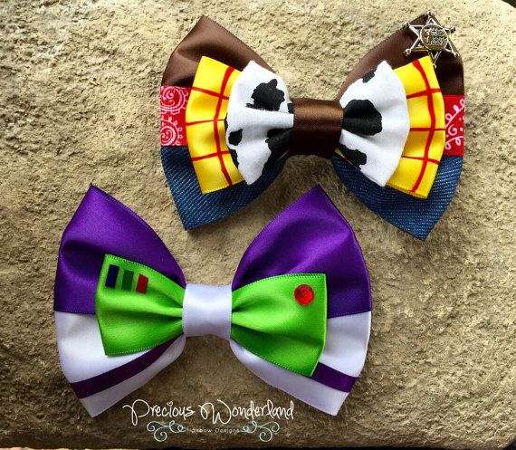 Theres a snake in my boot! This hair bow is a great accessory for any rootin tootin Cowboy or Cowgirl!  Yee-haw!  Please feel free to ask questions. Check out our listing for our Space Ranger bow!  Follow us on IG @PreciousWonderland for giveaways and coupon codes!  *Approximately 4.5 x 3 inches *Listing is for one bow *Handcrafted and made to order *Can be made with a barrette or an alligator clip *Not affiliated with Disney *Color may vary a bit depending on computer brightness setting…