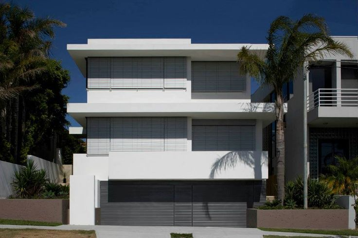 3 level luxury home by MHNDU - great use of external venetian blinds