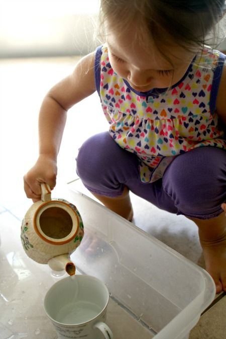 Toddler Pouring Activity...This was a fun activity that both the toddlers and preschoolers like during our T is for Tea Time theme.