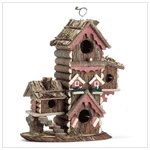 "This multi-level birdhouse ""condo"" offers lovable lodgings for several avian households. Thatched roofs and colorful trim make this a happy holiday retreat! If you would like to purchase this, email me for details."