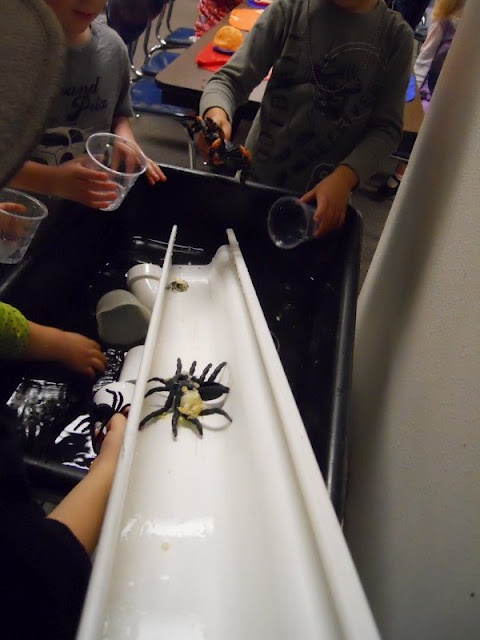 """Love this idea! The Itsy Bitsy and Great Big Spiders in the Sensory Table Add water, the rain gutter, and watering cans. We then had spiders of all sizes falling down the """"water spout"""" as we poured water."""