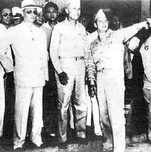 One of the last pictures of President Manuel Roxas (first from left) at Clark Air Base, Pampanga...his last photo. via Wikimedia Commons.
