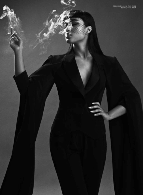 Natalia Kills. I love this picture to death! She reminds me of Morticia Adams, another one of my idols.