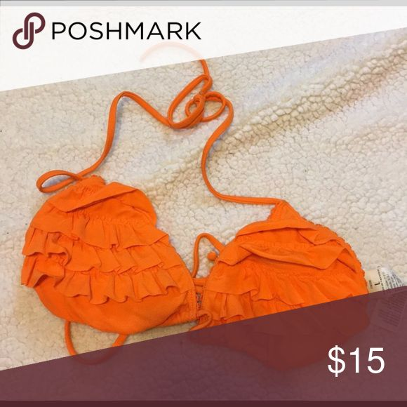 Orange top Orange hollister ruffle top. The picture looks messed up, that's just cuz of the ruffles, once it's on it looks like normal Hollister Swim Bikinis