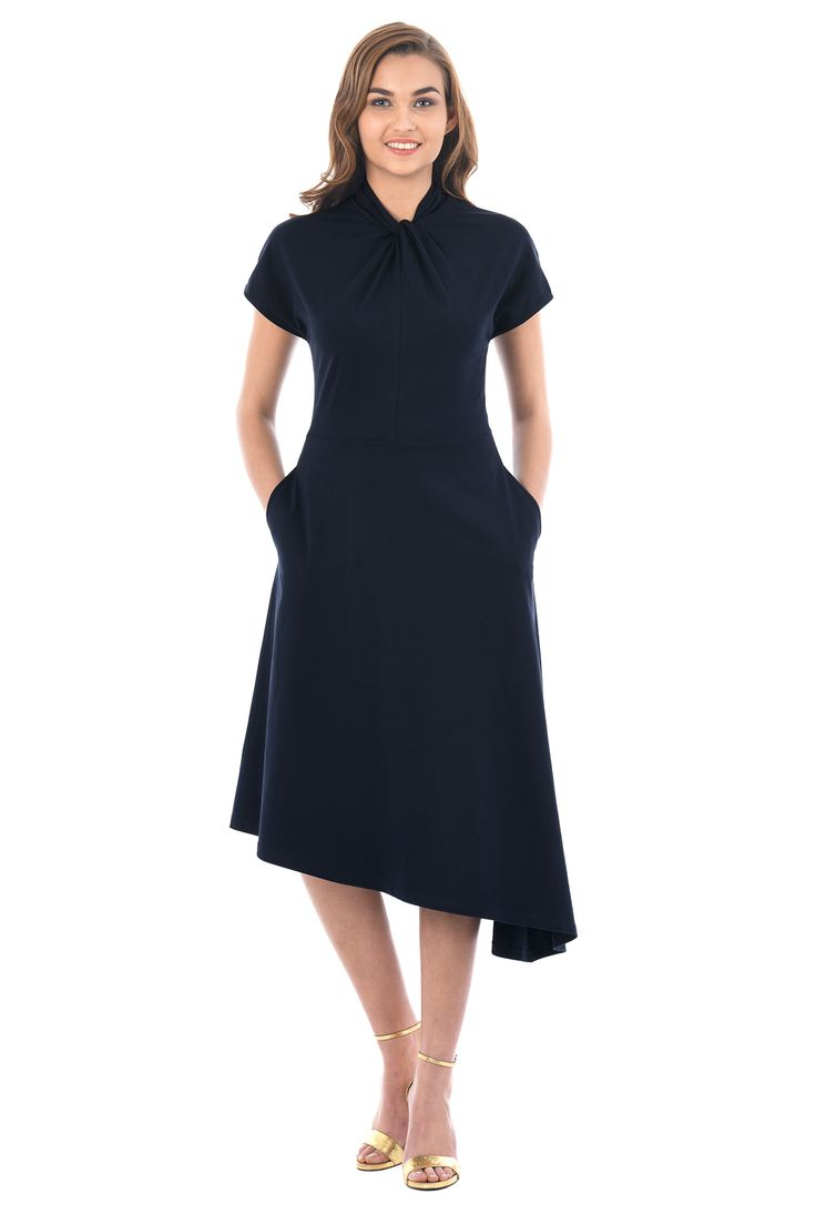 A knot front at the banded high neck enhances the feminine fit of our cotton jersey knit dress fashioned with an asymmetric hem at the full flare skirt.