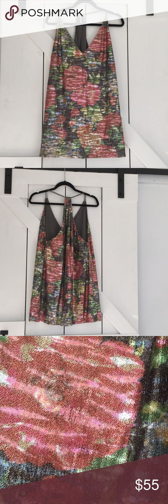 """NWOT Free People Sequin Dress Free People Tangier Floral Sequin Mini Dress. Racerback style and all over sequins. Fully lined (lining and straps are an olive green.) Flat measure 18"""" across the bust. About 31"""" from shoulder to hem. Free People Dresses Mini"""