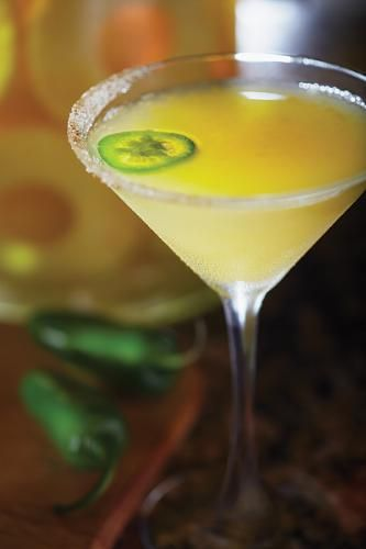 Bonefish Grill's Ocean Trust Tropic Heat Martini  1.5 oz Pineapple Infused Vodka 2 tbsp Diced Mango (strained) 1 oz Fresh Squeezed Lemon Juice .50 oz Spicy Mango Monin .50 oz Habanero Lime Monin 1 ea Round slice of Jalapeno Procedure: Muddle diced mangos, Spicy Mango Monin and Habanero Lime Monin into a pint glass until mangos are almost to a puree.  Add fresh squeezed lemon juice and pineapple infused vodka.  Fill pint glass with ice then shake 20x vigorously.  Strain into frozen…