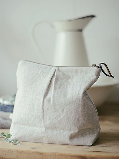 Handmade waterproof washbags in Peony and Sage Linen by L&S Interiors