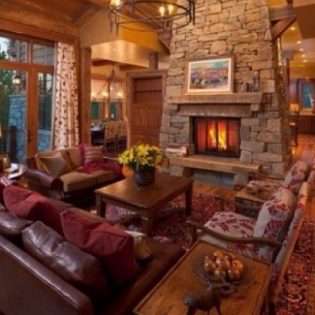 Love the large fireplace floating in the middle of the room.