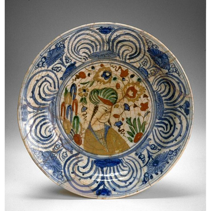 Dish with turban-clad youth Date: 1550-1650 Medium: Fritware with underglaze polychrome decoration Place of Origin: Northwestern Iran, probably Tabriz
