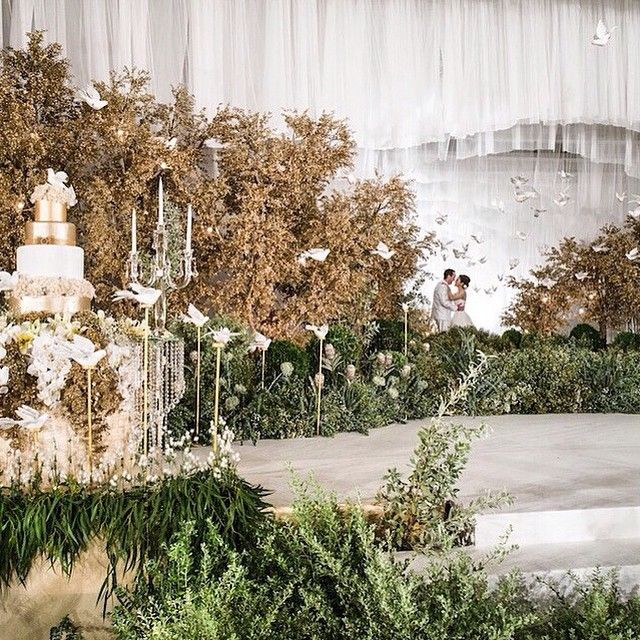 """@thebridestory's photo: """"Fairytale wedding by @rainforestthewedding. Grandeur decoration that incorporates white, gold and green color with birds adornments. Love it?  Visit www.bridestory.com for an extensive list of wedding vendors and inspirations."""""""