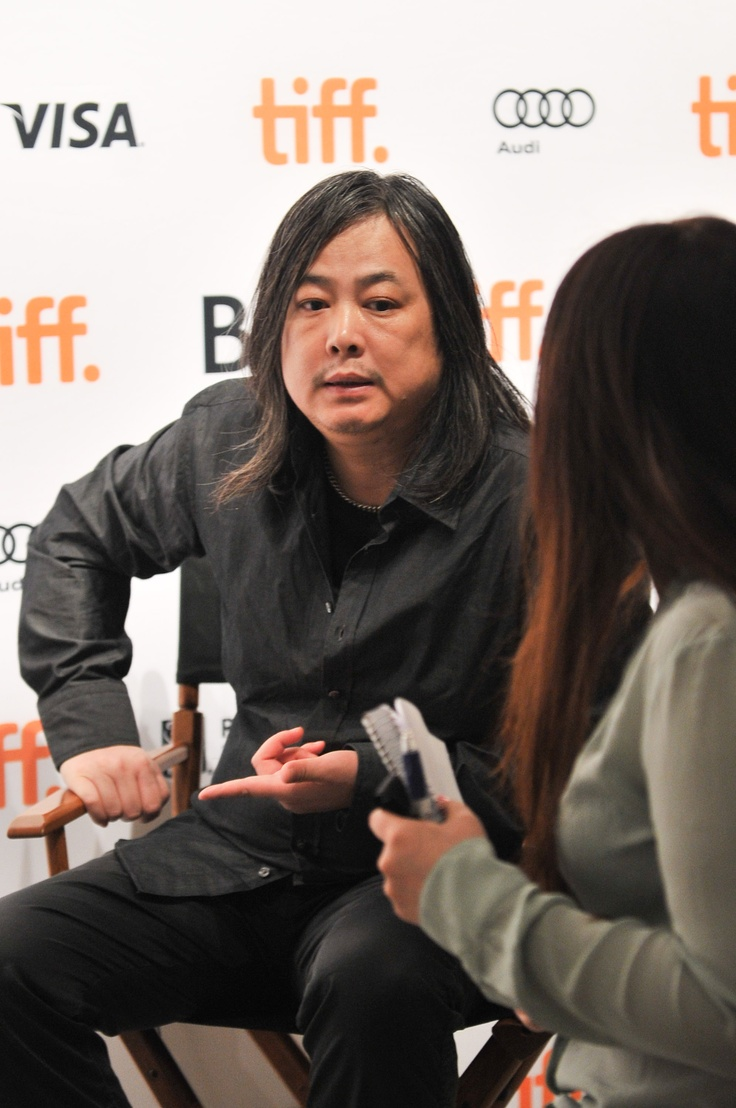 Yang Fudong being interviewed on the media preview day of his exhibition, Yang Fudong: New Women